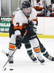 Northville's Tyler Balok looks to pass the puck agains