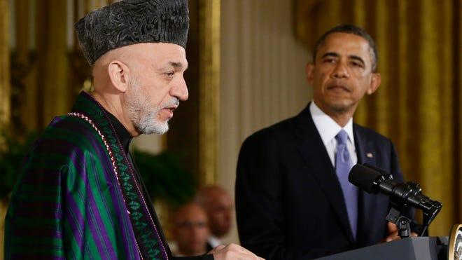 Presidents Obama and Hamid Karzai.