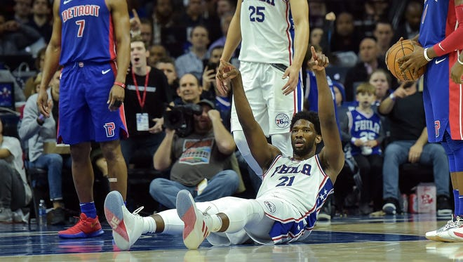 Dec 2, 2017; Philadelphia, PA, USA; Philadelphia 76ers center Joel Embiid (21) reacts after being fouled during the fourth quarter of the game against the Detroit Pistons at the Wells Fargo Center. The Philadelphia 76ers won 108-103.