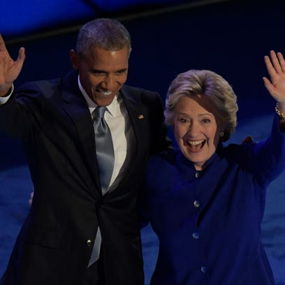 President Obama and Hillary Clinton on stage during