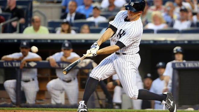 The Yankees' Brett Gardner hits a two-run home run to right, driving in Kelly Johnson, during the third inning of Tuesday night's game against the Toronto Blue Jays at Yankee Stadium.