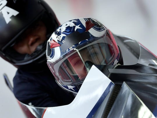 Driver Jamie Greubel Poser and Aja Evans of the United States arrive at the finish area during a training run for the women's bobsled competition at the 2018 Winter Olympics in Pyeongchang, South Korea, Monday, Feb. 19, 2018. (AP Photo/Michael Sohn)