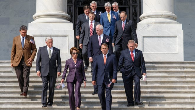Members of Congress arrive for a ceremony to remember the 9/11 terror attacks on Sept. 13, 2013, on the steps of the Capitol.