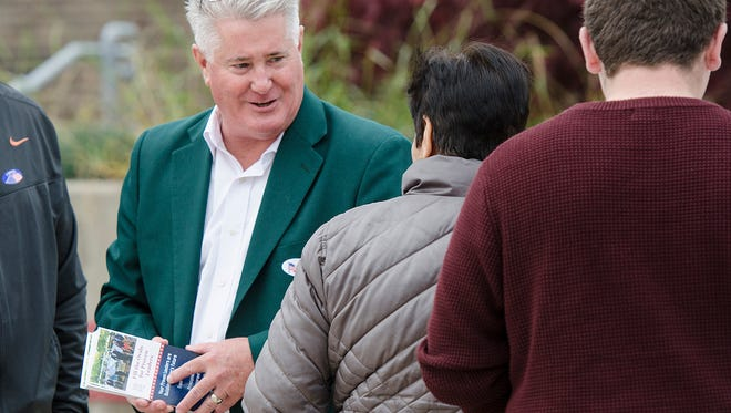 Township Trustee Pat Williams greets voters at Canton High School during the last day of his campaign to become township supervisor.