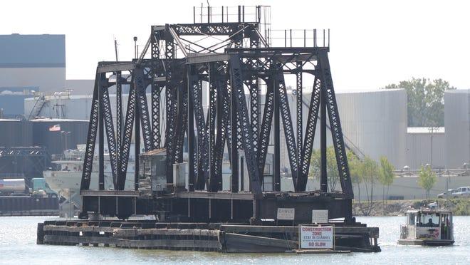 A workboat passes the Porlier Street railroad bridge on the Fox River.