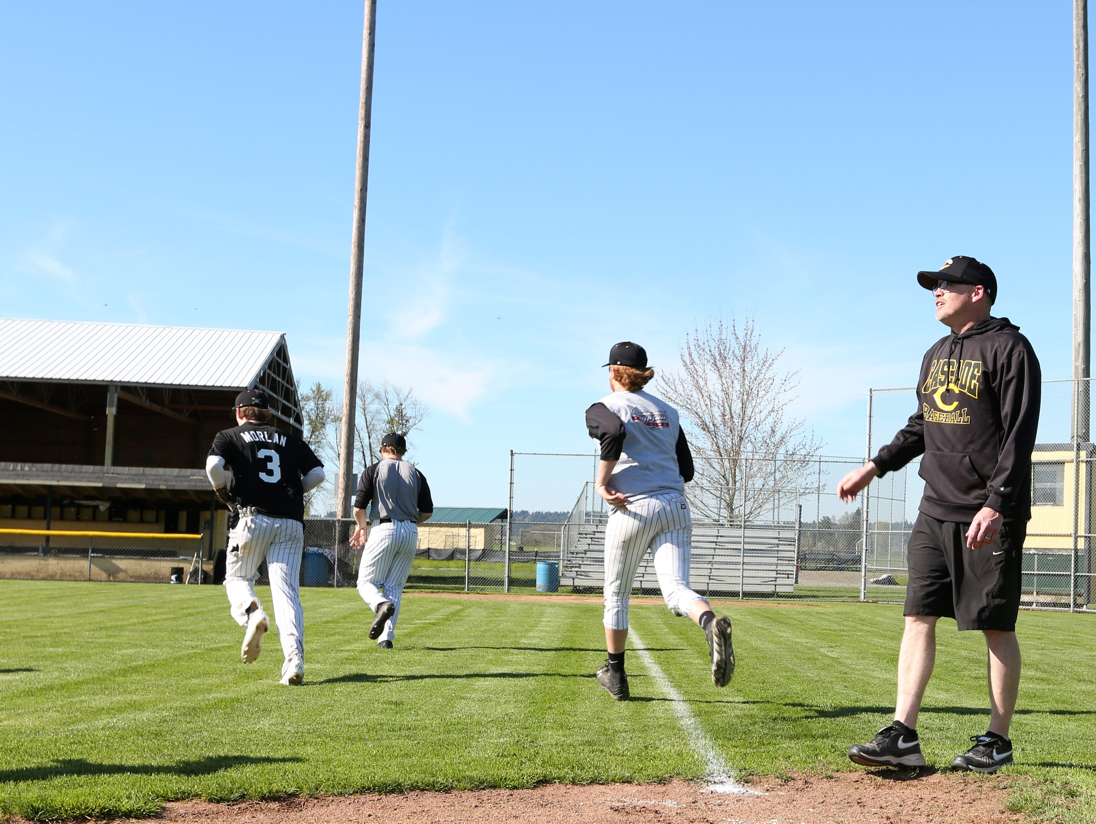 Head baseball coach Tim Ganfield works with players on Wednesday, March 30, 2016, at Cascade High School in Turner. Ganfield was head softball coach at Cascade for 14 years.