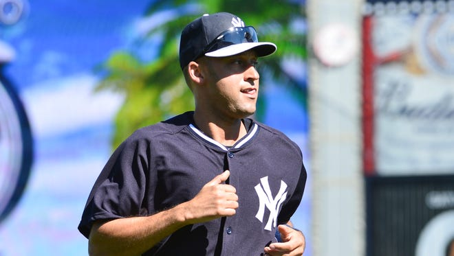 Derek Jeter runs during his first workout with the Yankees.