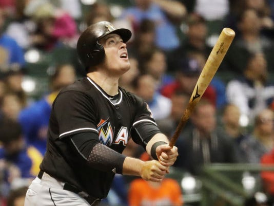 Miami Marlins' Justin Bour hits a home run during the sixth inning of a baseball game against the Milwaukee Brewers Friday, April 29, 2016, in Milwaukee. (AP Photo/Morry Gash)