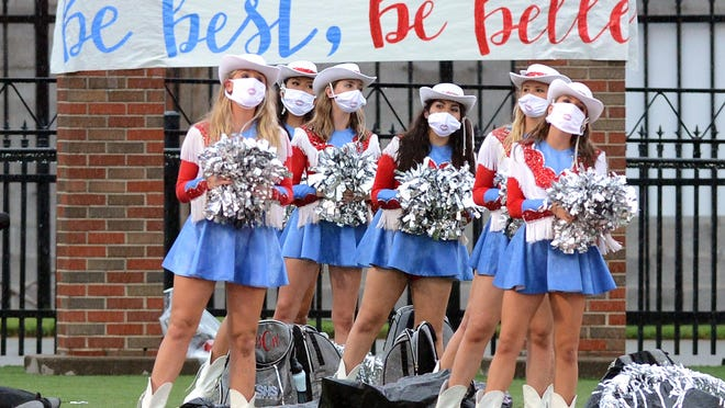 Members of the Southside High School Southern Belles during Southside's alma mater song prior to the Northside-Southside football game on Thursday in Mayo-Thompson Stadium.