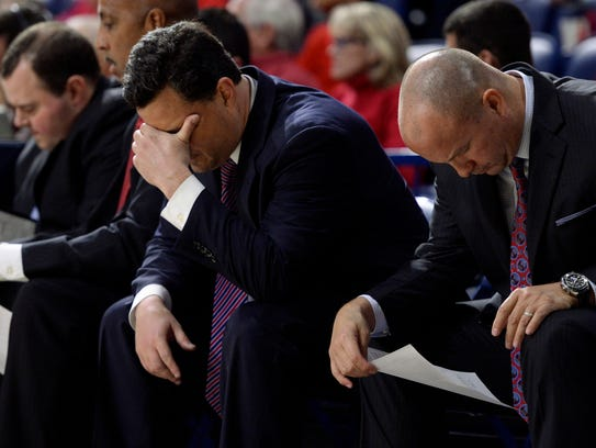Sean Miller puts his head in his hand during the second half of the Wildcats' win over Long Beach State on Wednesday.