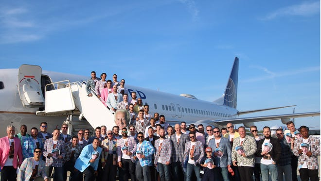 Brewers players dressed up with a Bob Uecker theme before hopping a plane to Pittsburgh.