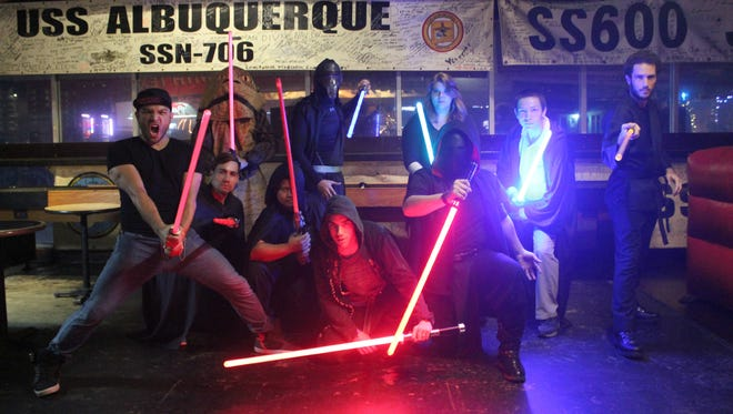 Members from the Jedi Council of Guam pose for a photo during meeting at Horse and Cow Tamuning on Dec. 9.