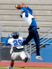 La Vergne's wide receiver Josh Lewis, left jumps to try and intercept a pass during practice on Wednesday, Nov. 1, 2017.