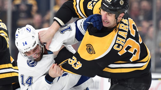 Boston Bruins defenseman Zdeno Chara (33) fights with Tampa Bay Lightning left wing Pat Maroon (14) during the second period at TD Garden on March 7, 2020.