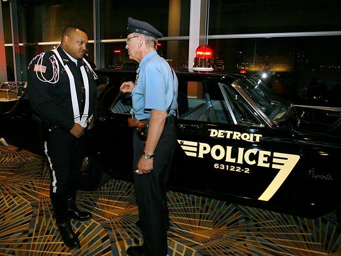 Officer Michael Moreland, left, and retired officer