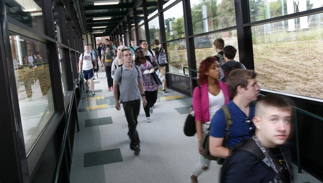 Northwest High School students walk in a hallway between the main building and outlying classrooms. Such connecting hallways enhance security.