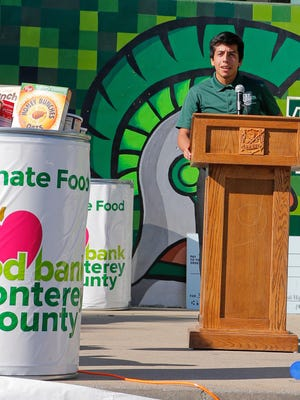 Alisal High School ASB President Bryan Vargas addresses the study body to congratulate them for gathering 16,000 pounds of food to donate to Food Bank for Monterey County
