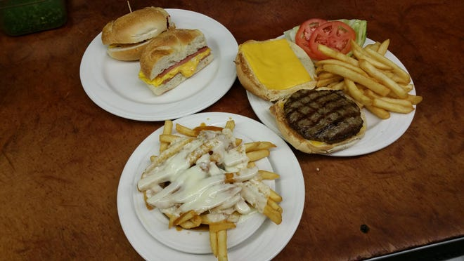 Three late night staples, clockwise from top left: Taylor ham, egg and cheese sandwich; cheeseburger deluxe; and Disco Fries served at the Nautilus Diner.