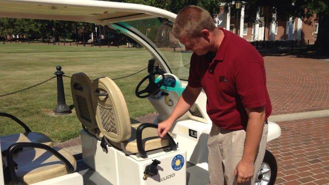 Josh Bounds, a senior studying engineering technology, surveys the all-electric Kudo Solar vehicle donated to the University of Maryland Eastern Shore.