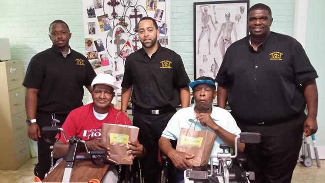 The Composite Lodge #126 of Monroe had their annual Father's Day drive at the Mary Gross Nursing Home. Presenting gifts were, from left, Willie Newell Jr., Desmond Jackson and Dexter Jones with residents, front, Charles Gross and Frank Battle.