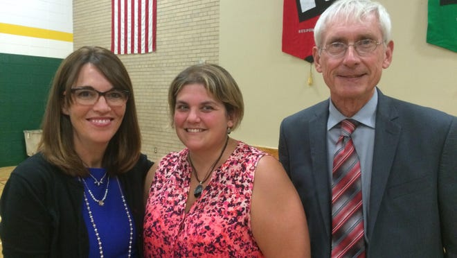 Pamela Gresser, center, poses with D.C. Everest School District Superintendent Kristine Gilmore and State Schools Superintendent Tony Evers Thursday.