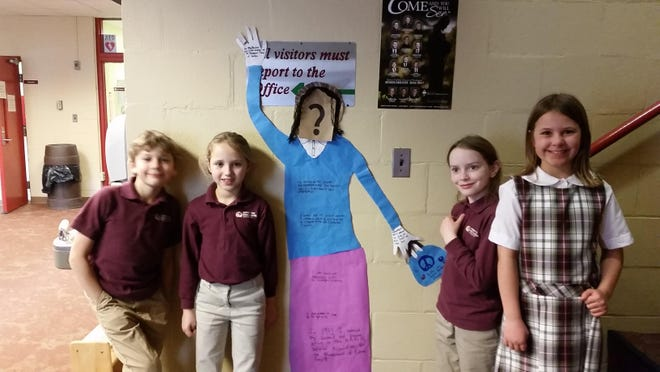 Third-graders worked in groups to create life-size representations of black history heroes they researched.