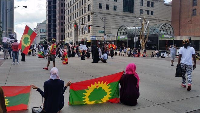 A group of 75 people from the Oromo community conducted a protest Thursday afternoon, July 2, 2020, against the Ethiopian government at Broad and High Streets in Downtown Columbus. The local protest was part a larger group of protests that occurred across the United States by the ethnic group. The people in the foreground are holding up the flag of Oromia, a region within Ethiopia.