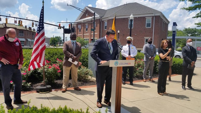 Mayor Andrew Ginther speaking at a press conference about youth gun violence at the corner of Cleveland and Eleventh Avenues on Monday, July 13, 2020.
