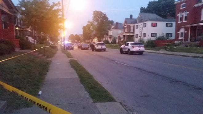 Columbus police cordon off the area around a car that stopped along East Livingston Avenue near the Linwood Avenue intersection on Thursday, Aug. 6. Perniel Hook, 17, was shot by a gunman in another vehicle that had been pursuing this car.