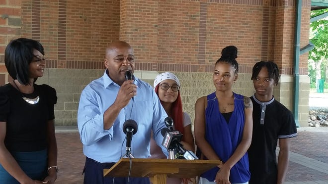 The Rev. Chuck Brown speaks Sunday, July 12, 2020, at the Gateway Building on Peoria' riverfront. He announced his candidacy for Peoria mayor in the April 2021 election standing beside his wife and children. [CHRIS KAERGARD/JOURNAL STAR