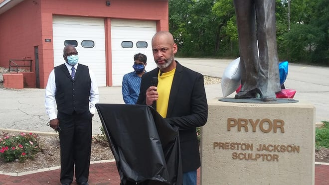 Couri Thomas announces his candidacy for Peoria mayor in 2021 during a speech in front of Preston Jackson's statue of Richard Pryor on Saturday in Peoria. Thomas placed second in mayoral balloting in the 2017 election.