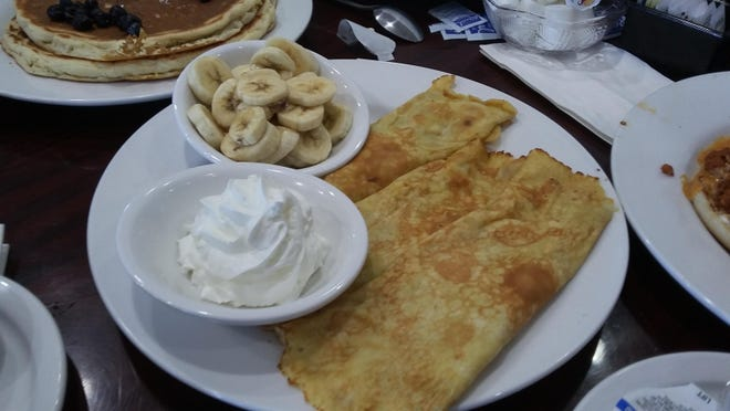 The Nutella crepes are one of the breakfast choices at Sweet Basil Cafe in Peoria.