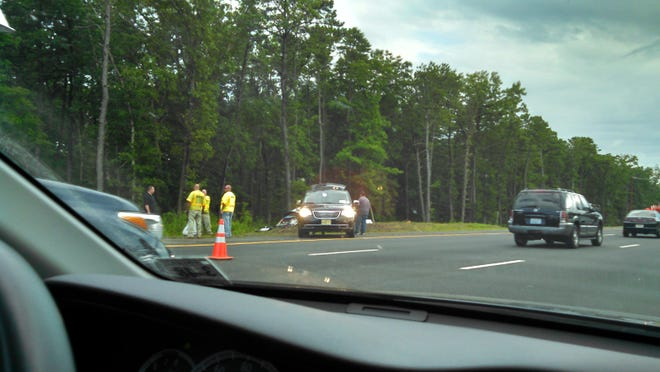 Investigators at the scene of Satuday's fatal car accident along the Garden State Parkway in Stafford.