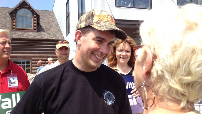 Republican incumbent Gov. Scott Walker greets supporters at Vandervest Harley-Davidson in Howard.