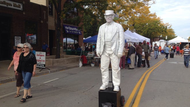 T.C. Hatter's dancing robot human statue awaits his next customer at the Farmers Market on Broadway.