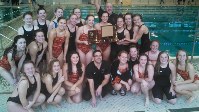 Brighton's swim team poses after winning its first Lakes Conference championship since 2008 on Saturday at Waterford Kettering High School. The Bulldogs posted a meet record 774.5 points.