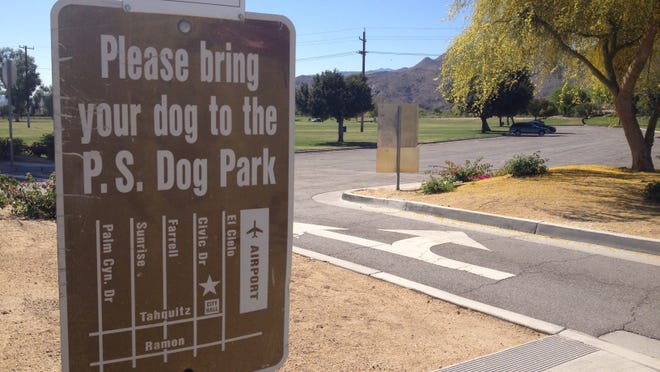 A sign at Demuth Park encouraged dog owners to visit the Palm Springs Dog Park, where dogs are allowed to go off-leash.