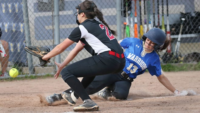 Webster Schroeder's Olivia Warren scores on a passed ball as Penfield pitcher Adriana Marini can't cleanly make the throw to cover home from her catcher Mary Brophy in the third inning during their Class AA quarterfinal game Monday, May 22, 2017 at Webster Town Hall Fields.