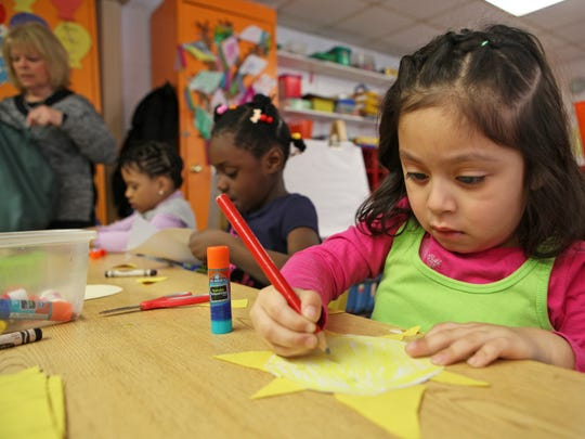 Leslie Agustin makes a sun with shapes during pre-kindergarten class at Temple Beth El, March 26, 2014 in Spring Valley. Temple Beth El is one of several sites East Ramapo uses for their Universal Pre-Kindergarten program.