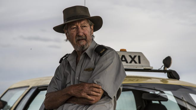 """Michael Caton takes a long drive across Australia in the dark comedy """"Last Cab to Darwin,"""" opening Friday."""