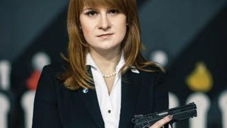 An undated handout picture made available by the Press Service of the Civic Chamber of the Russian Federation on chamber's official website shows  'The Right to Bear Weapons' Public Organization's Board Chairman Maria Butina posing with a gun in Moscow, Russia.