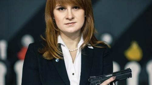 An undated handout picture made available by the Press Service of the Civic Chamber of the Russian Federation on the chamber's official website shows 'The Right to Bear Weapons' Public Organization's Board Chairman Maria Butina posing with a gun in Moscow.