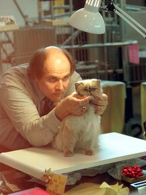 In this file photo, Donald Finger of Mosinee looks over a cat during the Central Wisconsin Cat Show.
