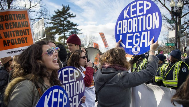 Pro-choice activists block the road against US Capitol Police, who are escorting the March For Life's path, in front of the US Supreme Court in Washington, DC, January 22, 2015. Tens of thousands of Americans who oppose abortion are in Washington for the annual March for Life, marking the 42nd anniversary of the Supreme Court's Roe v. Wade decision.