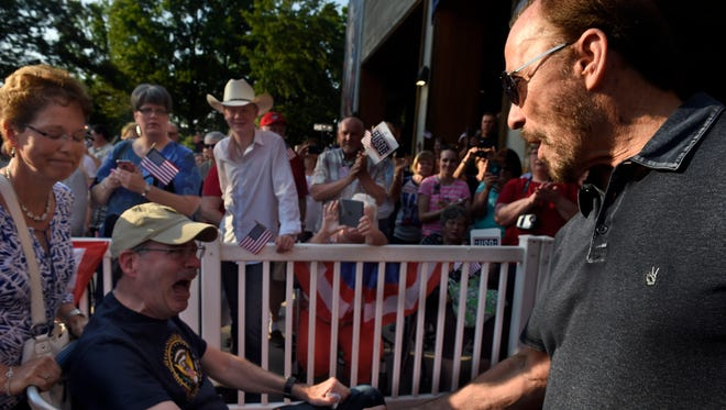 Lee Greenwood greets veterans Tuesday, May 24, 2016, as they arrive on the red carpet before the Opry celebrates the 75th anniversary of the USO.