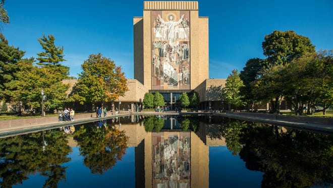 Ageneral view of the Hesburgh Library and Word of Life Mural, commonly known as Touchdown Jesus, before a Notre Dame football game last season.