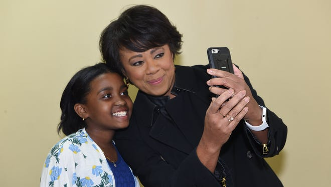 Janice Huff, right, meteorologist for NBC 4 New York, takes a selfie with Dallas Tulloch, 11, left, of Fishkill at the Tabernacle Christian Academy in the City of Poughkeepsie. Tulloch recorded herself reporting on the weather and sent it to NBC, who used it on the air.