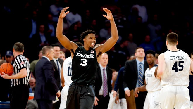Xavier Musketeers guard Quentin Goodin (3) encourages the crowd to cheer as the Musketeers took the lead over Butler.