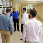 Chillicothe City Schools Superintendent Jon Saxton gives a tour of the middle and high school building to new teachers Monday at Chillicothe Middle School.
