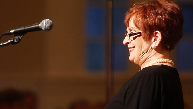 Breast cancer survivor Harriett Samler speaks Saturday at the 15th annual Concert of Hope and Remembrance in Anderson.
